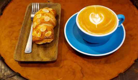 The delicious almond croissant and latte that I inhaled at Rue de Mansri.