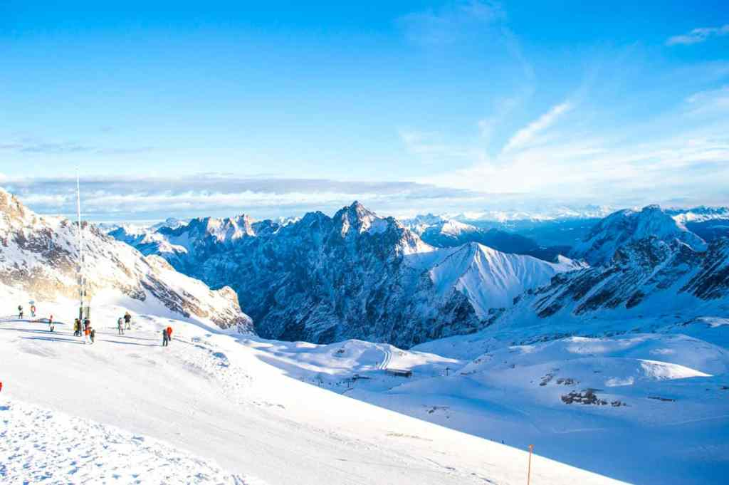 The stunning, snow covered view from the summit of Zugspitze in Germany.