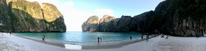 A panoramic view of famous Maya Bay on Koh Phi Phi Leh, taken at around 06:45 AM on December 15th, 2017. Notice that there is already a fair amount of tourists, despite this picture being taken very early in the morning. Source: Own work.