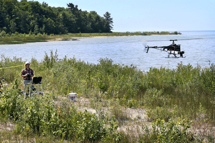Benjamin Heumann, a professor with Central Michigan University uses a drone to map threatened plant species