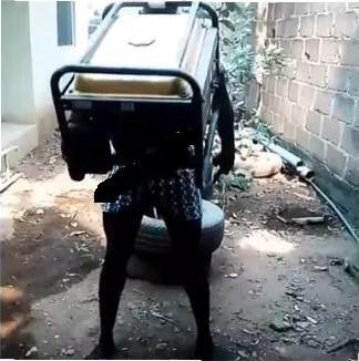 Shocker!!! Nigerian Man Carries Generator With His Teeth