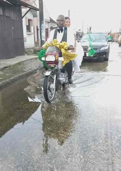 Couple ride bike home after their wedding party in Port Harcourt