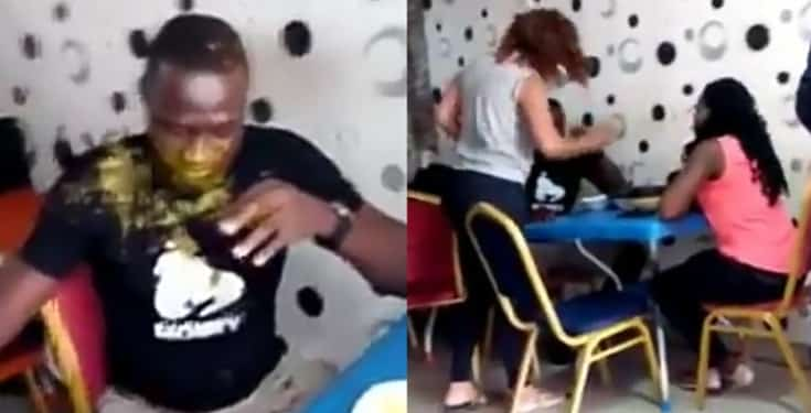Shocking as lady slaps husband multiple times, pours soup on him before side chick (Video)