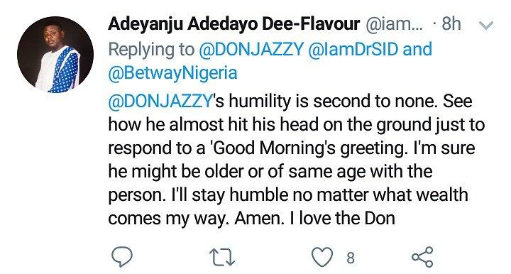 Don Jazzy bending to greet