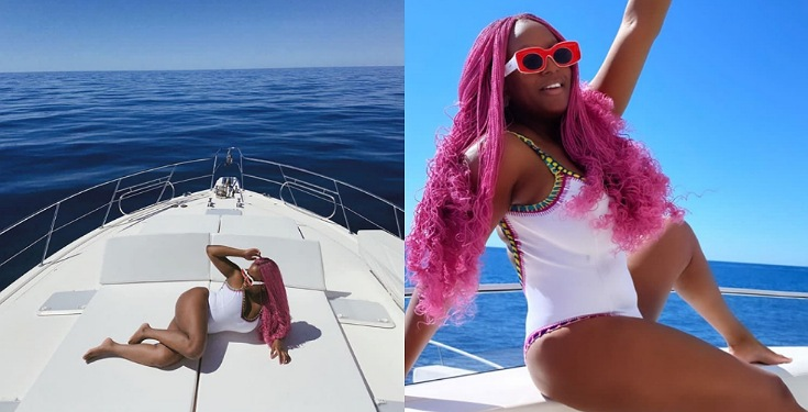 DJ Cuppy Dazzles In Swimsuit On A Boat Cruise In Monaco (Photos)