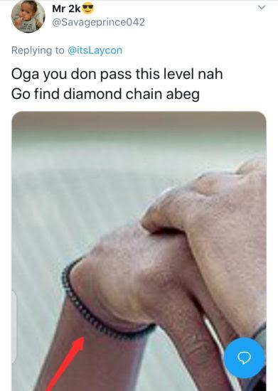 tweet of troll dragging laycon for not wearing diamond chain