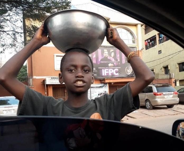 Young boy hawking sachet water gets scholarship, house, business for mom after stranger shared a video of him online