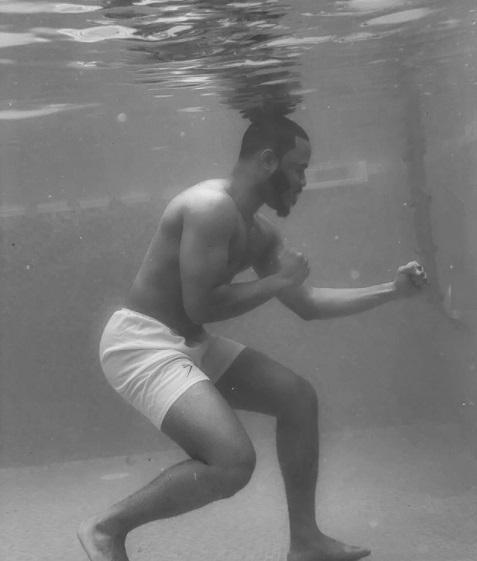BBNaija star, Ozo Recreates 1961 Picture Of Muhammad Ali Training In A Pool