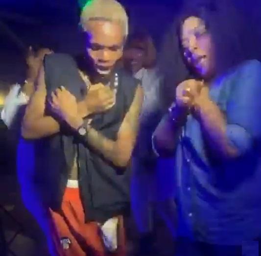 rita daniels and her son dancing in a club