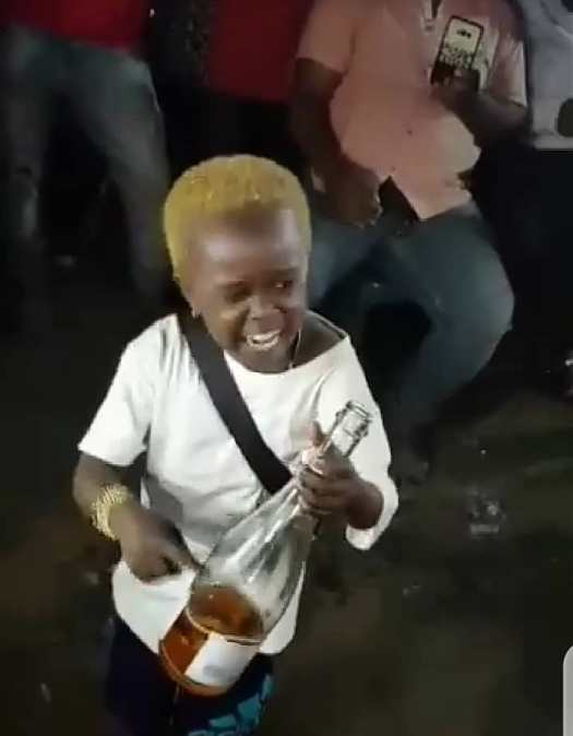 """""""Allow me to enjoy myself"""" - Little boy screams while consuming bottle of alcoholic drink amid cheers (Video)"""