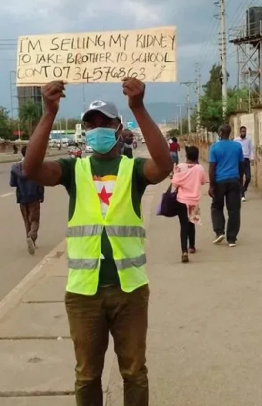 Man Goes Into The Street With Placard To Sell His Kidney To Assist Younger Brother