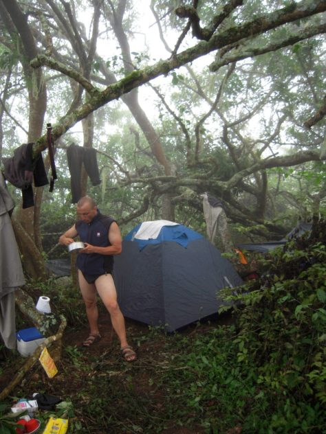 Eating after setting up camp on Vulcan Wolf, Galapagos.