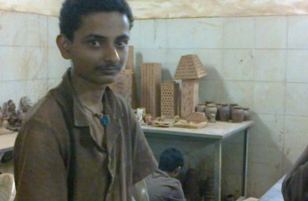 A beneficiary at NASEOH's pottery training center