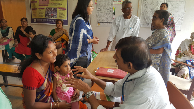 Doctors treating patients at an NGO camp
