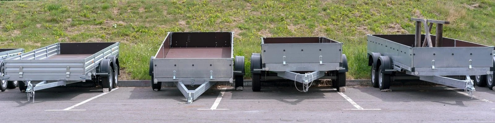 a row of utility trailers