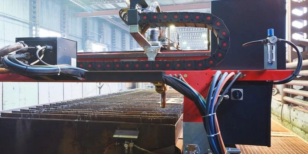 plasma torches of cutting machine close up in mechanical shop