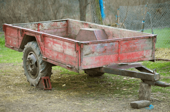 aged red utility trailer