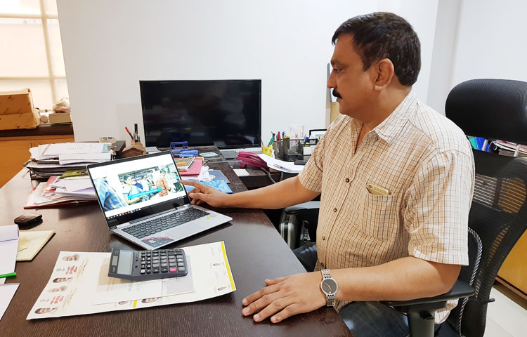 Managing Director of G.K Print House watches the official website of the company