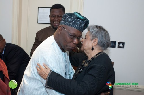 Co Chairs of the Commonwealth Africa Initiative Chief Obasanjo and Baroness Flather embraces as CAFI Africa Director Dayo Israel watches