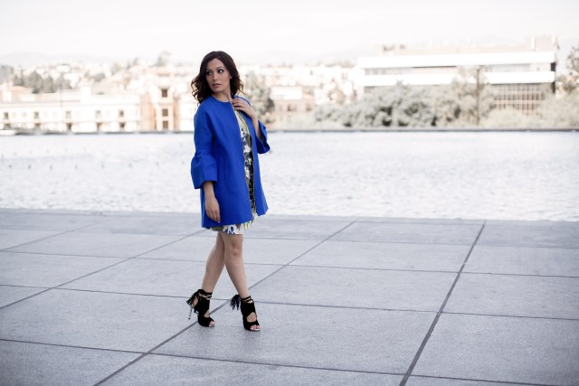 Fashion Blogger from Glam and Posh wearing bright blue bell sleeves coat