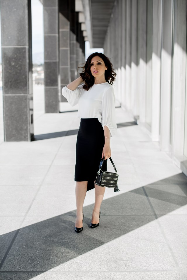 Fashion Blogger from Glam and Posh wearing a classic pencil skirt with a slit with a backless white top