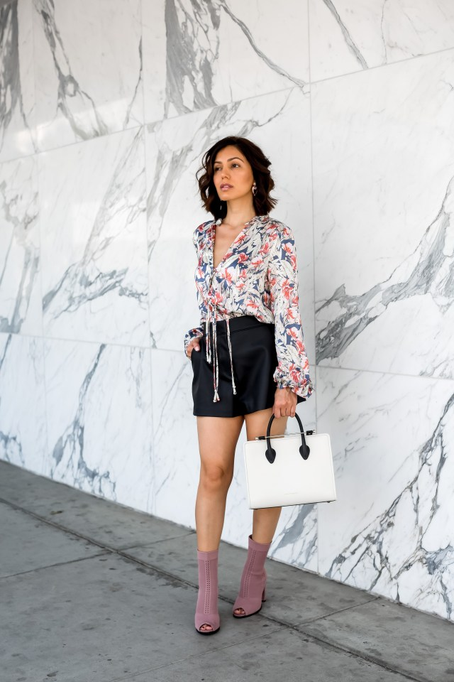 fashion blogger wearing leather shorts and long sleeve multi color short and open toe boots for Fall with Strathberry bag