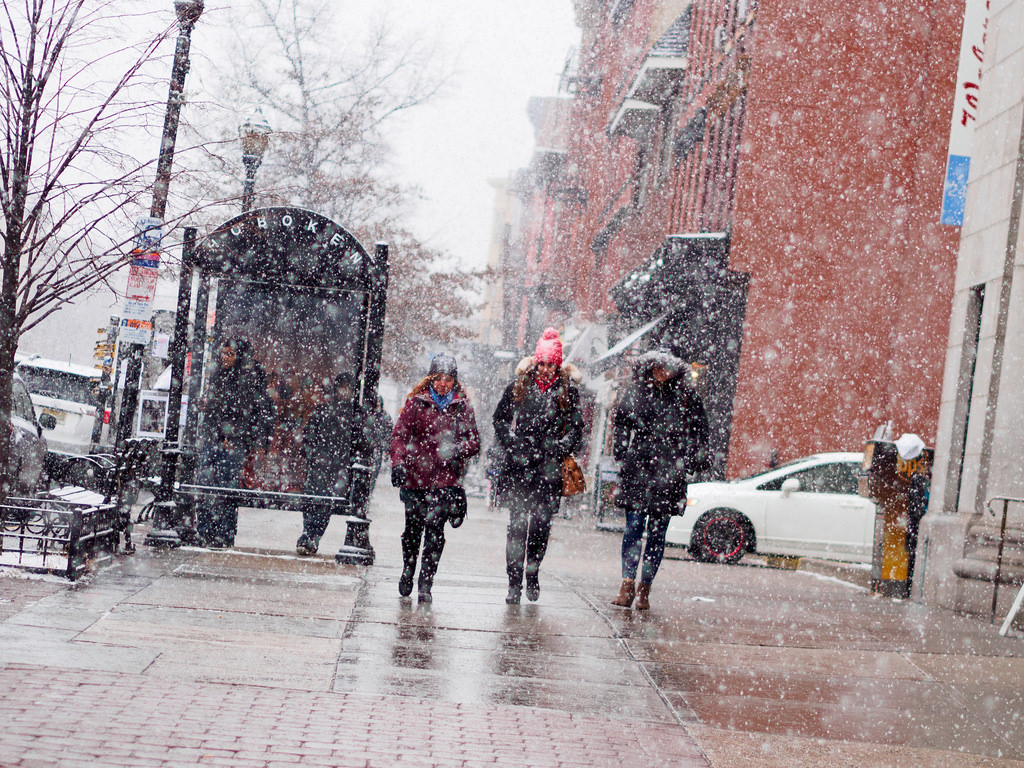 Group walking in snow in a city