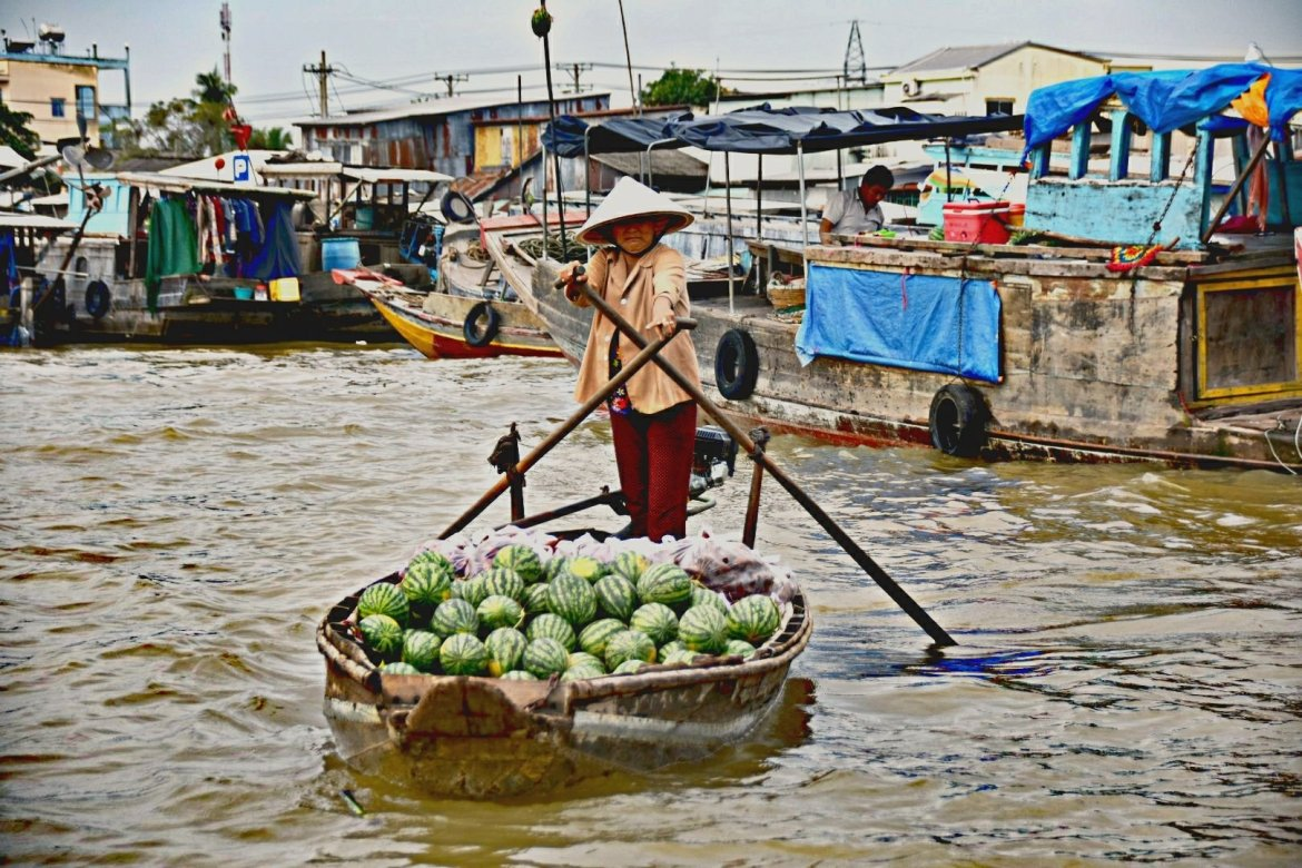 A local farmer selling watermelons from her boat in Vietnam's Mekong Delta