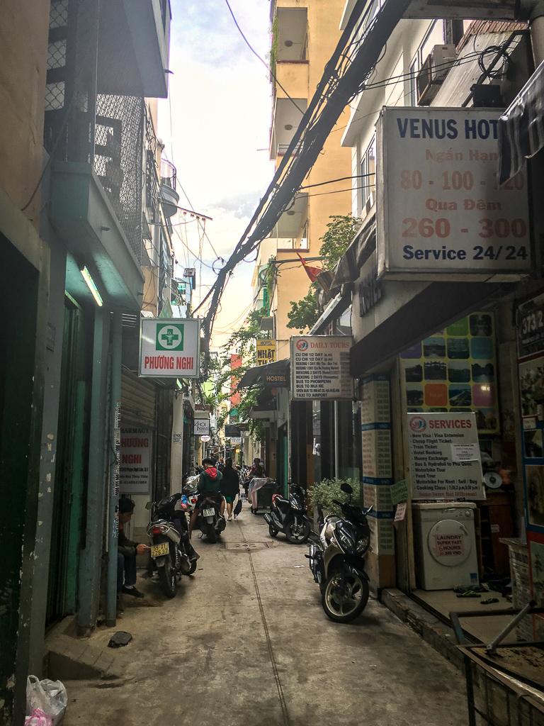 A sidestreet full of hostels in the backpacker neighborhood of Saigon