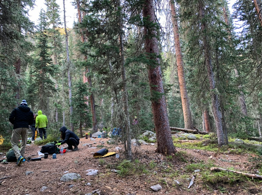 Breaking camp at Lower Granite Falls backcountry campsite in Rocky Mountain National Park