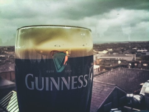 Pint of Guinness at the storehouse with Dublin behind