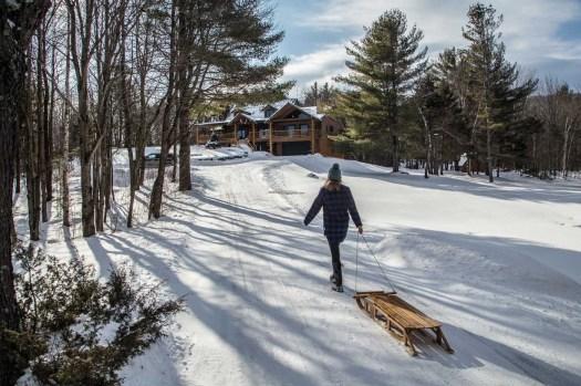 Glamping Blog News 8 Winter Activities Tobogganing - Kristen Kellogg