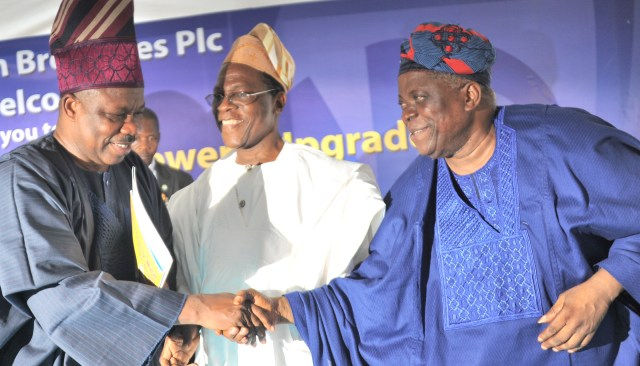 FROM LEFT TO RIGHT:  Senator Ibikunle Amosun, Executive Governor, Ogun State; Chief Kola Jamodu, Chairman, Nigerian Breweries and  Chief Abraham Akanle, representative of former president Olusegun Obasanjo at the commissioning of  the upgraded  Ota brewery on Wednesday