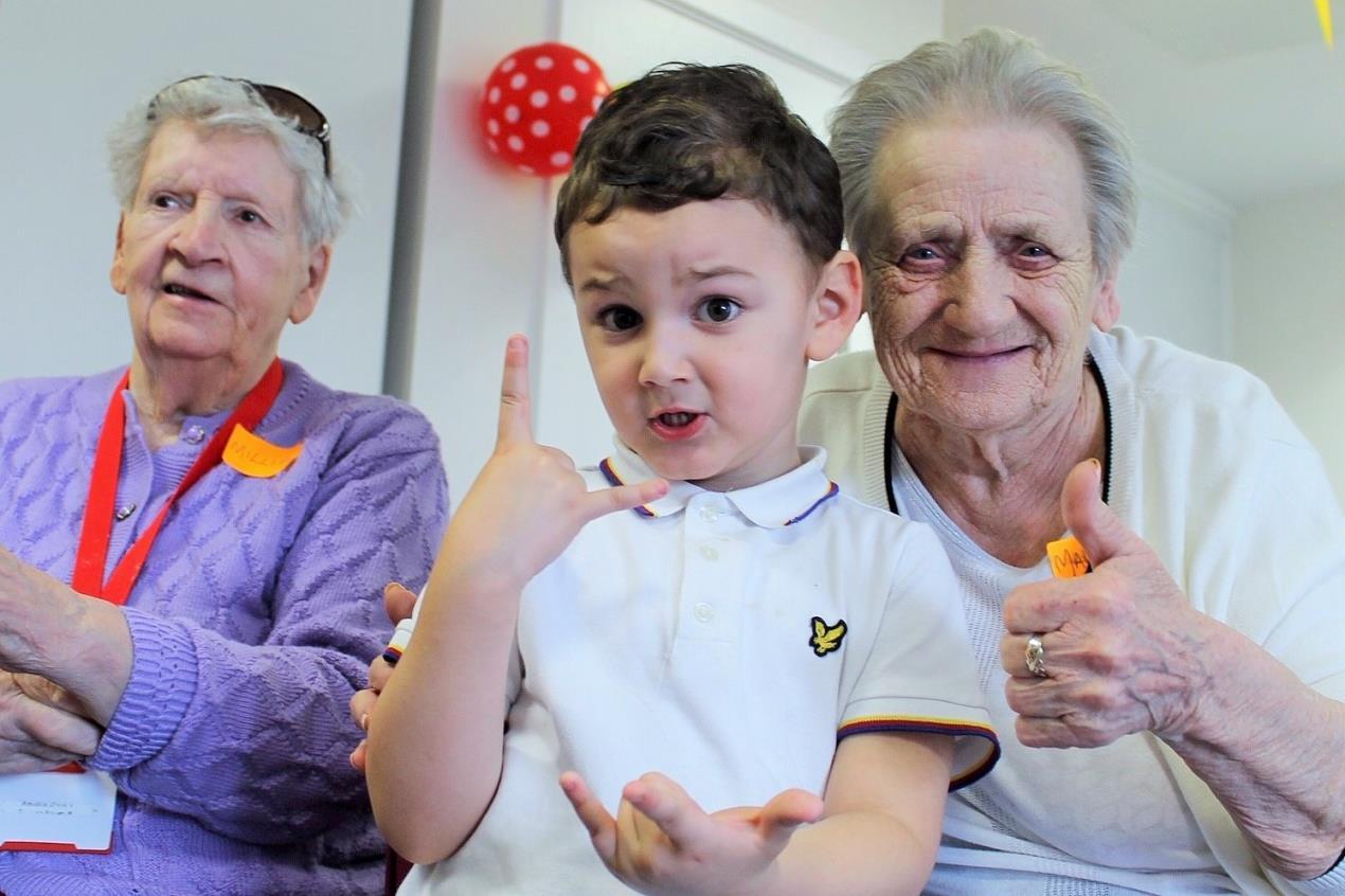Mark Kane aged 4 with Millie (left) and Margaret