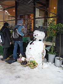 Photo: Snowman and fruit.