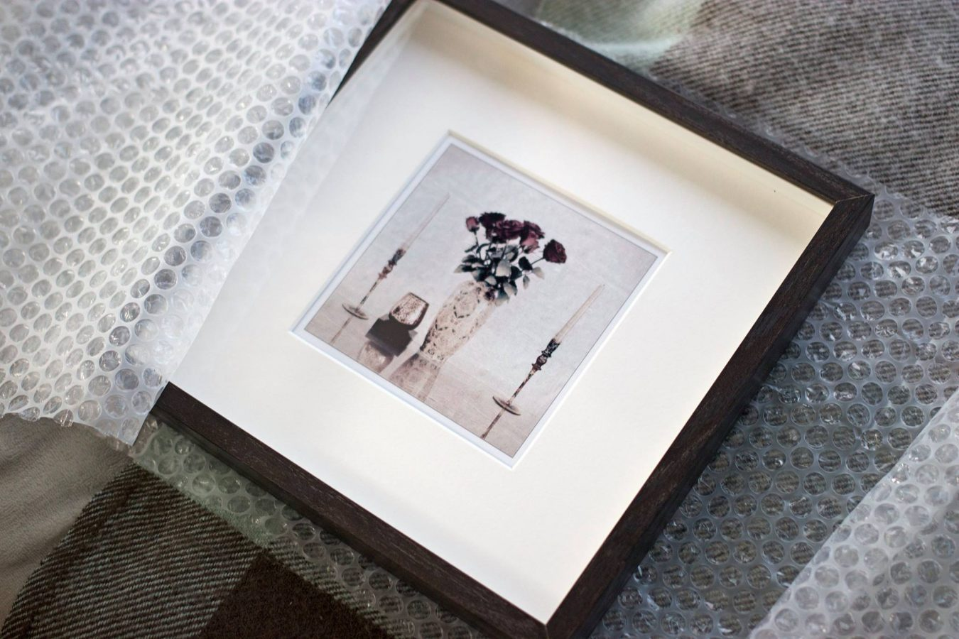 Framed photo still life with vase and candles