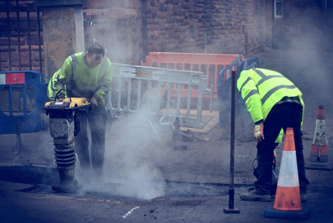 Workmen repairing the road
