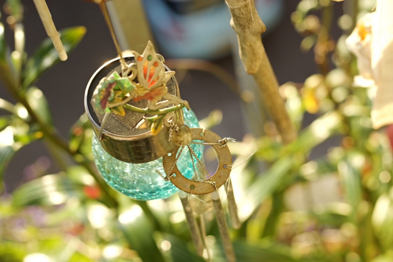 Pat's balcon arnaments. Catch the butterfly if you can.