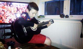 ryan guitar football strip
