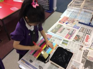 Step 2: Painting over our lovely colours with black paint and washing up liquid!