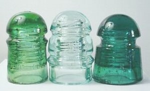 Three Brookfield Glass Company insulators: CD 102; CD 112; CD 103.