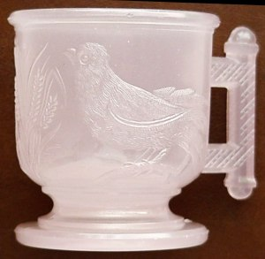 EASTLAKE bird mug in pink alabaster or pink clambroth, made circa early to mid-1880s.