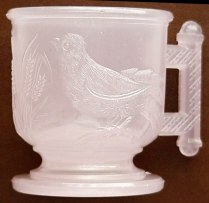 EASTLAKE bird mug in pink alabaster or pink clambroth, made circa early to mid-1880s.