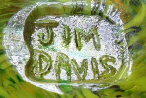 Signature as impressed on base of yellow bird paperweight