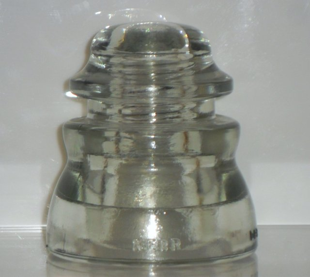 KERR  DP1  glass insulator, CD 155 type in off-clear glass. This example is marked with a 1976 date code.