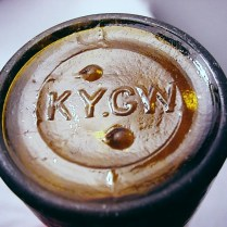 Amber beer bottle with KY.G.W. mark on bottom.