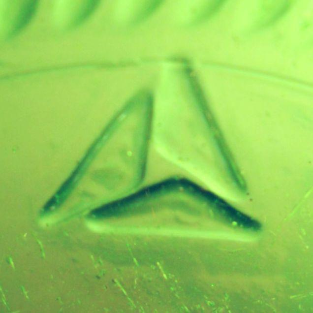 American National Can Company mark, triangular / sailboat logo