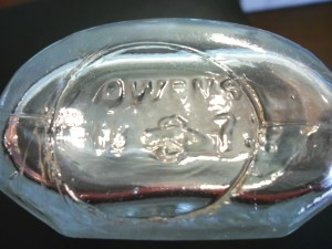 OWENS and diamond-oval mark on base of clear druggist bottle