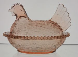 "Indiana Glass hen in pink. The color may get close to what some collectors would call ""Peach""."