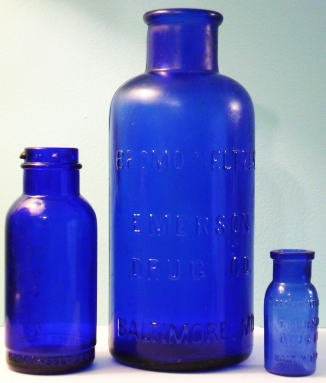 Cobalt blue glass Bromo-Seltzer bottles in three sizes